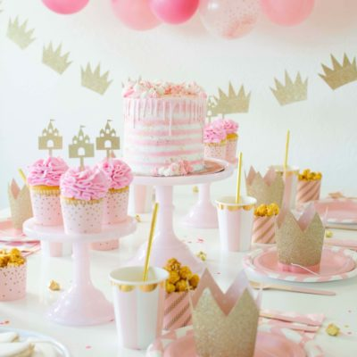 pretty and pink princess kids party decorations and tableware with balloon garland