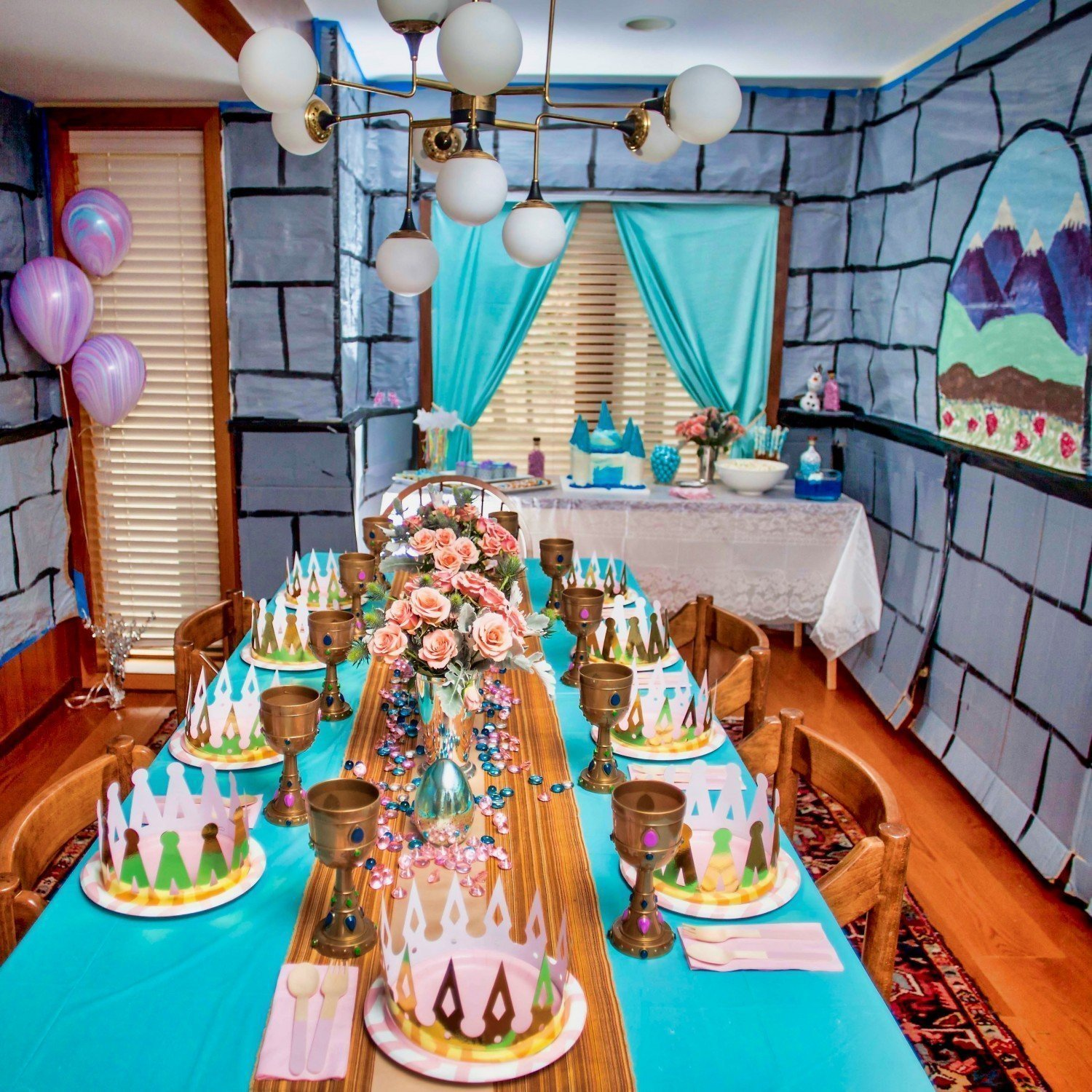 Complete princess party room with wall decorations and set table