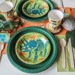 Dinosaur Theme Party Table Set Up with dino-mite plates and cups