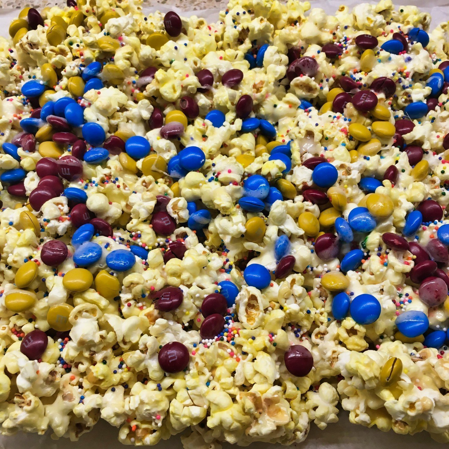 circus popcorn with red, yellow and blue M&M's and sprinkles