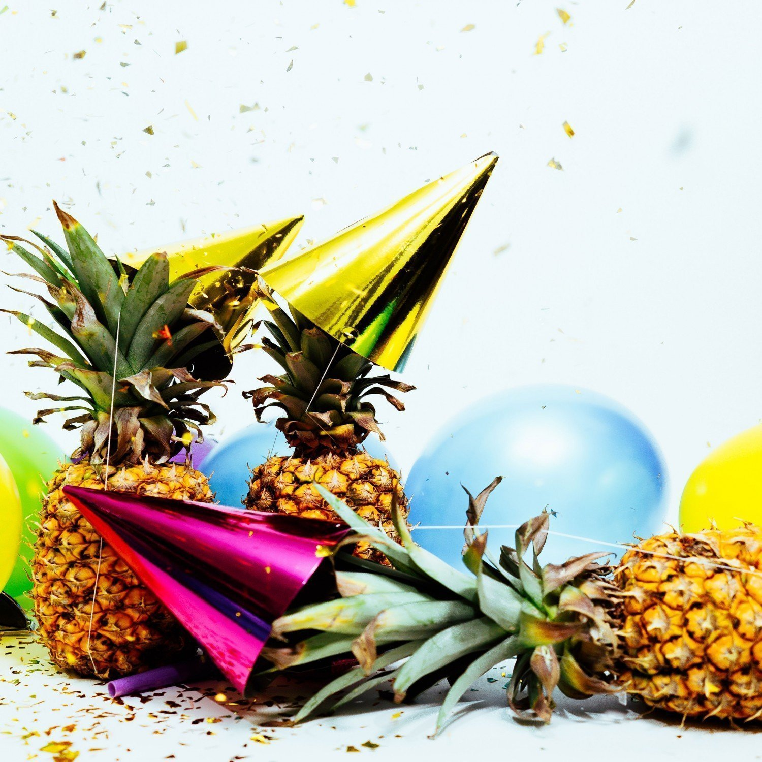 fallen pineapple at a crowded party