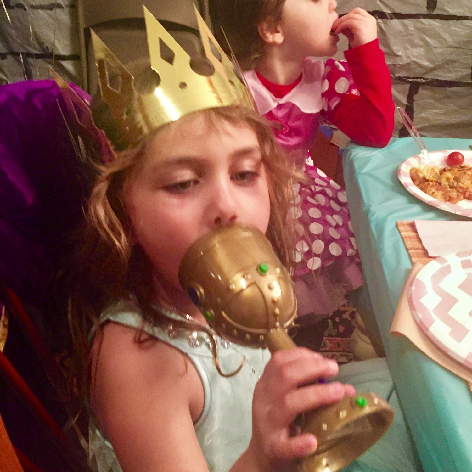 girl drinking from princess party goblet