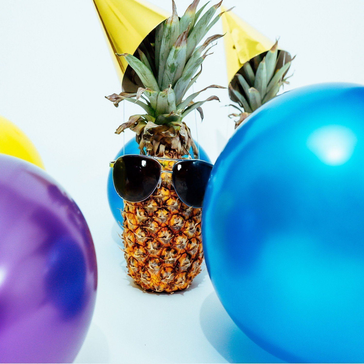 crowded lonely pineapple at a party